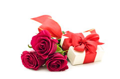 Roses and gift box Stock Photos