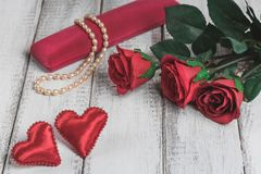 Roses, gift box with bead and a hearts on wooden board, Valentines Day Stock Photography