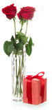 Roses with gift box. Beautiful three red roses with gift box isolated on white background Stock Images
