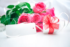Roses and gift box with a card Royalty Free Stock Photos