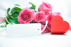 Roses and gift box with a card Stock Image