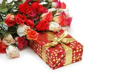 Roses and gift box isolated Stock Images