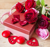 Roses and Gift for Valentine's Day Royalty Free Stock Photography