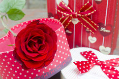 Roses and gifts on the occasion of Valentine's Day. Stock Photos