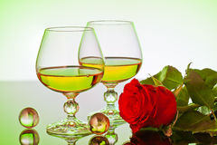 Roses and glass Stock Images