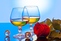 Roses and glass. Background can use the Internet, print advertising and design Royalty Free Stock Photo