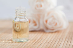 Roses and a glass phial Stock Photography