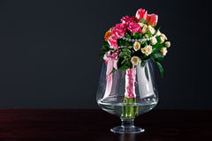 Roses in glass vase Stock Images