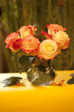 Roses in a glass vase. A bouquet of roses in a glass vase on the sun terrace Stock Photo