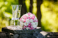 Roses and glasses of champagne Stock Photos