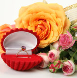 Roses and a gold ring Stock Photos