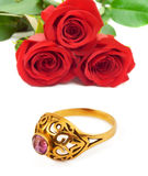 Roses and golden ring Stock Images