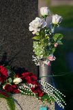 Roses on gravestone. Pearls, red and white roses on gravestone Stock Photo