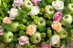Roses and green apples Stock Images