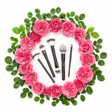 Roses green leaves pink flower head wreath beauty flat lay Stock Photos