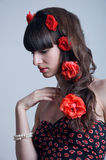 Roses in hair Stock Images