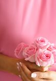 Roses in hands Stock Photography