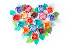 Roses heart. Paper roses arranged in a heart shaped on a white background Stock Image