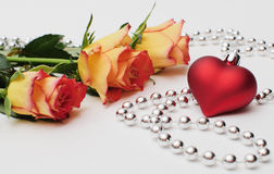 Roses and heart. Roses, heart and silver beads, isolated Stock Photography