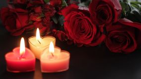 Roses and Heart-shaped candles for Valentines Day. In 1080p stock footage
