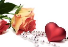 Heart and roses. Roses, heart and silver beads, isolated Royalty Free Stock Photography