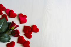 Roses and hearts on white wooden table
