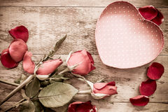 Roses and a hearts on wooden board, Valentines Day background Stock Photography