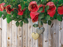 Roses and a hearts on wooden board, Valentines Day holiday background