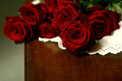 Roses and lace on table still life 3. Red roses on white lace Royalty Free Stock Images