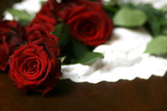 Roses and lace on table still life 6. Red roses on white lace Royalty Free Stock Images