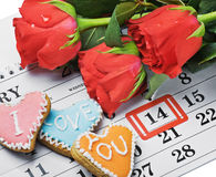 Roses lay on the calendar with the date of February 14 Valentin stock photos
