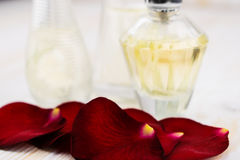 Roses leafes and perfume. On wooden background Stock Image