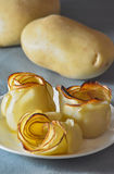 Roses made of baked sliced potatoes Stock Photography
