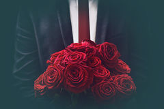 Roses. Man offers a bouquet of roses Royalty Free Stock Images