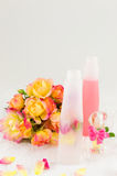 Roses and massage oil. Roses and rose massage oil royalty free stock photography