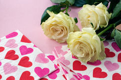Roses and napkins with red hearts.  stock image