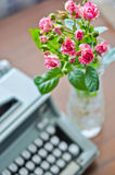 Roses and old type-writer Stock Photography