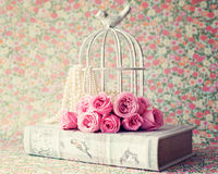 Roses over vintage book Stock Photography