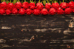 Roses over wooden background Stock Images