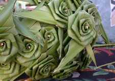 Roses Palm Leaf. I was treated to a master weaver of palm leaves in Hawaii. This was a beautiful group of roses she created Stock Photos