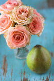 Roses and Pear Stock Photography