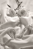 Roses and Pearls. Soft sepia atmospheric shot of roses and pearls. Good for Mother's Day, Valentines, feminine concept and background uses. Focus on the pearls Royalty Free Stock Photography