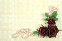 Roses and pearls Stock Images