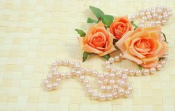 Roses and pearls. Framework on wooden background from roses and pearls Royalty Free Stock Photos