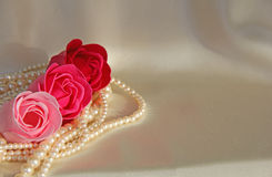 Roses Pearls on cream satin lingerie Stock Images