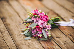 Roses, peonies and mix of summer flowers bouquet on wood. Background for the wedding in Europe Stock Images