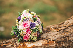 Roses, peonies and mix of summer flowers bouquet on wood Stock Images
