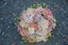 Roses, peonies and silk in a delicate, pastel, dusky pink bridal bouquet. Wedding arrangements, floral setting, accessories, concepts, details, ideas and themes Stock Photography