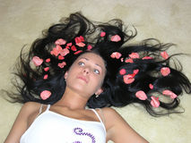 Roses petals in hair Stock Photo