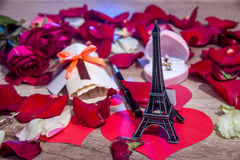 roses petals, money, bottles of wine, a box of jewels and Eiffel Tower. Stock Image
